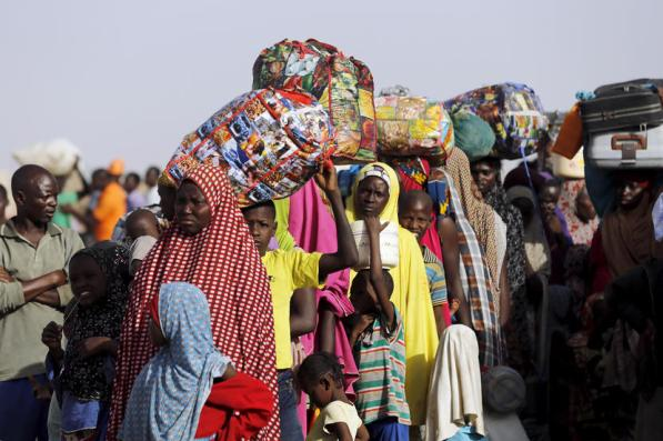 Returnees queue during the evacuation of Nigerians displaced by Boko Haram militants, at the camp for displaced people in Geidam, Yobe state, Nigeria