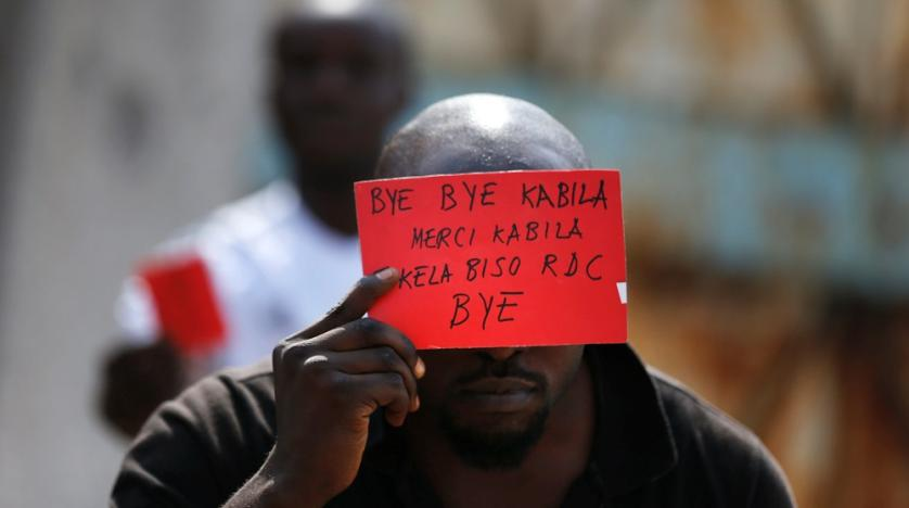 a_congolese_opposition_party_supporter_displays_a_red_card_against_president_joseph_kabila_in_kinshasa_congo_in_2016._reuters